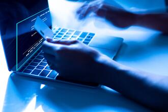 concept-credit-card-theft-hackers-with-credit-cards-laptops-use-these-data-min