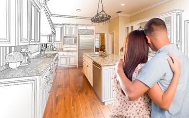 Photo of a couple looking at a model for a new kitchen