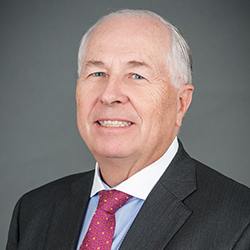 Charles E. Snyder,  CEO